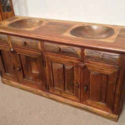 Kasselmann's - Its a teak wood vanity with a built in wooden sink, custom made in Thailand