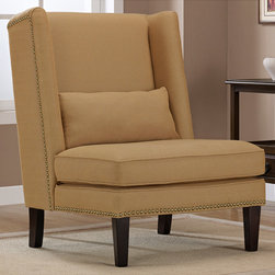 None - Wing Chair Harvest Linen - Imagine curling up with a good book in this comfy wing chair in a warm butterscotch cotton/poly blend with espresso wood legs, welt cord detail, and stylish nail head trim. This generous seat has an attached seat cushion and includes an extra pillow.