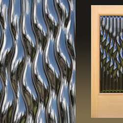 "Sculptural Glass Doors - ""Flow"" – Contemporary cast glass entry door - ""Flow"" – An artful contemporary glass entry door whose rhythmic forms evoke the quiet power of water, shown here with glass detail. Made to order from Sculptural Glass Doors, featuring ClearCast™ Glass. Choice of glass colors and other options are available. Doors are shipped flat rate nationwide. Made with integrity in USA."