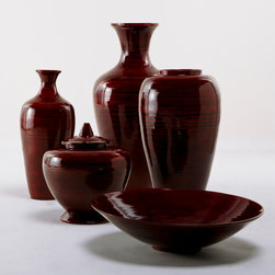 Red Lacquer Bamboo Vase - The zen-like lines of this red lacquer pottery dovetails nicely with chalet chic. Simple, strong and focused, the pieces would work very well in a sophisticated ski cabin.