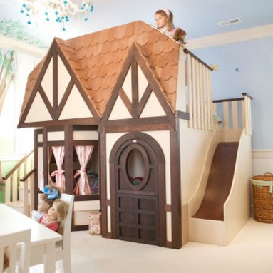 """Girls Princess Castle Loft Bed - Where do I begin? First, let's put the insane jealousy aside. OK. This is a girl's bed and playhouse contained in a charming, Tudor-style cottage facade. It is as customizable as your budget will allow. This one has stairs on one side to enter it and a slide on the other for a fun ride down. I must admit, if I found myself in the """"unlimited budget"""" category, I would have one made for my daughter in larger proportions to also accommodate me. The upper level would be perfect for impromptu tea parties, and a few woodland creatures placed outside would complete the fairytale."""