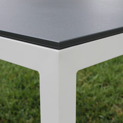 Indoor/Outdoor - The Jug Dining Table is a bright addition, indoors or out.  This tough, modern, contract-quality table features a strong aluminum frame topped with vivid 100% recycled milk jug plastic top. This eco-friendly table has adjustable leveling feet.  Table is made to order, available with nine table top colors.