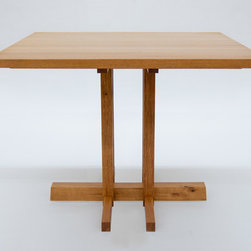 Small Kitchen Dining Table - This small dining table is crafted from reclaimed white oak and finished with a durable hardwax oil. The table seats four, but is fitted for two extensions that allow it to accommodate up to six.