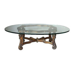Pre-owned Gilded & Glass Coffee Table - This glass oval coffee table with ornate gold gilded x stretcher base would be the perfect staple for your living room. The ornate details give it a personality of its own but are also subtle enough to blend in with various interior design styles.