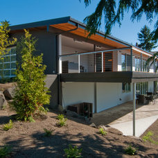 Midcentury Exterior by BUILD LLC