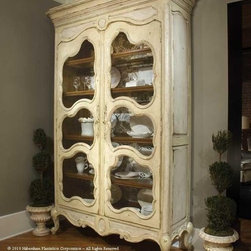 """Habersham - Habersham Camille Armoire - It all started in the small North Georgia town of Clarkesville. It was 1969 and Habersham founder Joyce Eddy had just been given the chance to operate a small antique shop located above an old laundromat. This was just the opportunity a woman of Joyce's vision and energy would turn into the perfect blend of utility artistry and soul. Looking for ways to make her antique business more profitable she began crafting small decorative purses from vintage wooden cigar boxes. They were totally unique and they were an instant hit. Joyce named her new venture Habersham Plantation after Georgia's Habersham County and the plantations for which the area was known. The ideas just kept coming. One day Joyce was driving by a local textile company and spotted a large pile of old discarded wooden spools. Those spools were soon crafted into candleholders towel racks and folk art items. With the help of her sons and other family members Joyce expanded Habersham's offerings to include handcrafted furniture reflecting the American Country designs of the early 17th and 18th centuries. As word spread and production demands grew Joyce enlisted the help of woodworkers from her North Georgia region. This area had been a center for cabinetmaking since the early 1800s and the master craftsmen were well-schooled in the time-tested woodworking and joinery techniques that matched Joyce's sense of style and function. She even designed her factory to work just as the 18th century cabinetmakers did with individual artisans hand-finishing signing and dating each piece of furniture they crafted. Today Habersham still leads the way in the fine art of furniture design. So much so that in addition to their product line a new """"whole home"""" concept is finding its way into some of the finest dwellings in the country. Custom kitchen bath and other cabinetry designs offer rich opulent finishes and blend seamlessly with rooms of casual elegance all enhancing today's graci"""