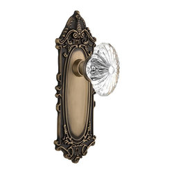 Nostalgic - Nostalgic Privacy-Victorian Plate-Oval Fluted Crystal Knob-Antique Brass - The Victorian Plate in antique brass, with its distinct curvilinear embellishment, is unmistakably old world vogue. Combined with our Oval Fluted Crystal Knob (24 individual hand-ground facets!), the look is elegant, but never fussy. All Nostalgic Warehouse knobs are mounted on a solid (not plated) forged brass base for durability and beauty.