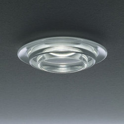 Leucos - Sun Recessed Downlight - Sun recessed downlight features an acid-etched, poured glass diffuser available in a clear crystal or satin white glass trim. Provides a narrow to wider beam spread depending on the lamp, as well as a soft pleasant glow. Housing options include Remodel Housing, New Construction , Insulated Ceiling, Chicago Plenum, Air Tight and Vapor Tight. Available in LED version. One 50 watt, 12 volt, MR16 bipin halogen lamp not included. Downward light distribution. c/UL listed for damp locations. 5.25 inch diameter x 1.13 inch height.