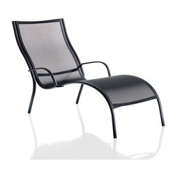 Magis Paso Doble Outdoor Chaise Lounge - Paso Doble Outdoor Chaise Lounge design by Stefano Giovannoni is a stacking chair with arms and crosspieces in die-cast polyester powder painted aluminum in black or white. The seat and backrest constructed of polymer mesh making the chair lightweight and portable.