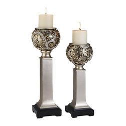ORE International - 2-Pc Vine Candleholder Set - Includes small and large candle holder with vanilla scented candles. Designed to resemble the romantic era. Uniquely sophisticated design. Shattered glass molted together to create decorative feature. Warranty: 30 days. Made from polyresin. Silver color. No assembly required. Small: 5.5 in. Dia. x 18 in. H. Large: 6 in. Dia. x 21.5 in. H. Weight: 5 lbs.Placing these candle holders anywhere in the room creates a calm and romantic sensation. The round parts of these pieces are designed to look like vines.