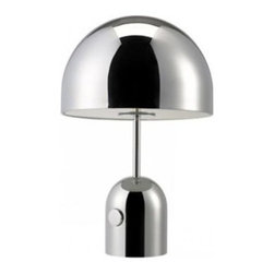 Tom Dixon - Bell Table Lamp by Tom Dixon - Exploring the super-shiny, the Tom Dixon Bell Table Lamp demonstrates the beauty in stark minimalistic form by reducing this design to two dome components. Not only is the hyper-polished, mirrored chrome surface highly reflective of its surroundings, but the light situated within the white interior of the upper dome is aimed downward, reflecting off the base dome as well. Tom Dixon has a vast commitment to design creativity and a mission to redefine how products are made and sold. The Tom Dixon lighting and furniture collections reflect all of his cutting-edge design and manufacturing innovations, from the product's shape and form to the raw materials and production processes used.