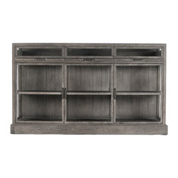 Kathy Kuo Home - Hazel Creek Industrial Loft Gray Oak Display Entertainment Wall Cabinet - A stunning showcase for displaying your favorite collections or an entertainment center that puts everything at your fingertips, this strikingly stylish centerpiece fits the bill beautifully. Weathered grey deeply-grained oak is gorgeous against sleek glass. Unique, museum-quality shallow drawers pull out so items may be interchanged quickly and easily. Three glass doors protect the contents of this contemporary cabinet.