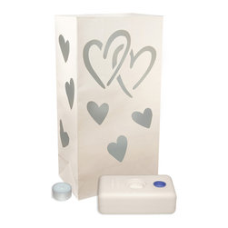 LumaBase Luminarias - Candle Luminaria Kit Hearts - Luminarias will create festive lighting for your special event. The paper bags and the LumaBases are flame resistant. The LumaBase is a water weighted base that will anchor the bag and hold the 4 hour tea light secure. For outdoor use only. Included: 12 Flame Resistant Paper Bags, 12 Tea Light Candles, 12 LumaBases