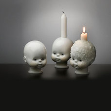 eclectic candles and candle holders by Theo