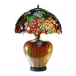 Warehouse of Tiffany - Grape Lamp w Ceramic Base - Tiffany shade. 2 Pull chain. Uses two 60W light bulbs. Has 372 cut glass and 205 cabochons. Features a charming ceramic oval base. Minimal assembly required. 20 in. L x 20 in. W x 28 in. H (10 lbs.)Unique amazing piece of art with an oval shade that is so narrow and yet so wide. It's composed of Green leafy vines and cluster like grapes in colors of Green, Purple, Red and Amber. Has 372 cut glass and 205 cabochons. This lamp features a charming ceramic oval base uniquely different. Measures 28 in. H x 20 in. W, requires two 60 wattage light bulbs.