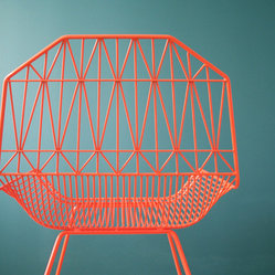 The Farmhouse Chair - Here is a geometric neon-orange chair (be still my heart).