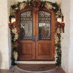 Castille Double Door - Arch top mesquite double door with Castille iron by The Front Door Company.