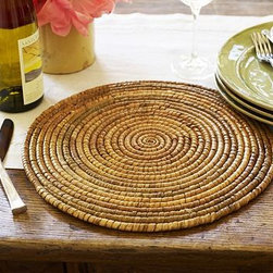 """Paros Rattan Round Charger - Strands of natural rattan are tightly woven by hand to create swirls of shifting hues on our Paros charger. The relaxed beauty and sturdy construction make it perfect for everyday use. 14"""" diameter Woven of rattan with a lacquer finish."""
