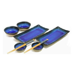 MySushiSet.com - 8 PC Deep Sea Blue Sushi Serving Set - For wedding or anniversary gift ideas you might consider this stunning Deep Sea Blue Sushi Serving Set. Dramatic and elegant this gorgeous sushi gift set is sure to make a big impression on anyone. With two rectangular sushi plates that have graduated layers of blue and green that end in edges of deep black that continue down the outside, their centers are a spectacular royal blue that will dazzle. Two round soup bowls continue the display mimicking the design of the Japanese artisans and two smaller soy sauce dishes carry on the theme. Golden Pagoda Chopsticks add their own positive attitude with a golden wood that is topped with a dark blue mosaic design. As a holiday gift idea or gift idea for any special occasion like a wedding or birthday, you can't go wrong with this beautiful set.