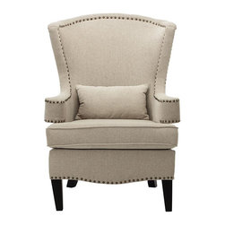 Home Decorators Collection - Testoni Wingback Chair - Our plush Testoni Wingback Chair will bring a touch of class to your space. Its smooth lines and sophisticated styling offer the perfect blend of traditional and contemporary design. Whether you're looking to update your den or living room or create a reading nook, this chair will add the perfect finishing touch. Soft upholstered chair offers comfort and classic styling. High-quality frame crafted from hardwoods. Includes small pillow. Features nailhead details. Legs in black finish.