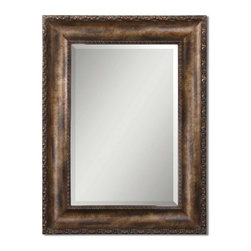 Uttermost - Leola Beveled Mirror In Wood FrameGrace Feyock Collection - Frame features an antiqued bronze wash with gold leaf undertones, burnished details and a gray wash.