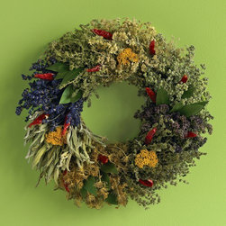 Viva Terra - Culinary Herb Wreath With Hanger - A tasteful wreath in every respect, its spray of culinary herbs adds savory fragrance to your kitchen and can be clipped off for use at will. Crafted from organic marjoram, dill, thyme, sage, lavender, anise, cinnamon sticks, and   yarrow, our beguiling wreath is accented with chili peppers.