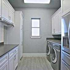 Transitional Laundry Room by Atwood Custom Homes