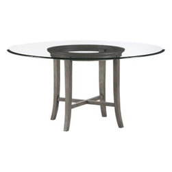 "Halo Grey Dining Table with 60"" Glass Top - Halo's simple beauty lies in its open presentation of materials, construction and design. The ""halo"" is a trick of light created by the glass top that's perfectly flat on the surface but has a deep, light-refracting reverse bevel on the underside. A solid chestnut wood base echoes the halo with its own center top ring in grey-washed lacquer. Minimal flared legs and an architectural cross-brace of the same wood connect so precisely that no screws or nails are required."
