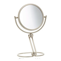 Jerdon MC449N 5.5-Inch Folding Two-Sided Swivel Travel Mirror with 10x Mag - The Jerdon MC449N 5.5-Inch Folding Travel Mirror is an ideal bathroom and makeup accessory that can be taken on all your journeys, helping you maintain your look wherever you go. This smart travel mirror folds flat and features a cleverly designed stable base with a convenient tilt adjustment and 360-degree swivel rotation to angle this mirror however you please. The MC449N comes with a velveteen travel pouch to protect its surface, making it easy to stow in suitcases, handbags and storage bins while you're on the go. The two-sided, 360-degree rotating design offers a regular reflection of 1x magnification and 10x magnification to make sure every detail of your hair and makeup are in place. The mirror is 5.5-inches in diameter and can stand upright on countertops, vanities and tables, making it an ideal companion on all your trips. The MC449N features an attractive nickel finish that is not only aesthetically charming, but protects against moisture and condensation. The Jerdon MC449N 5.5-Inch Folding Travel Mirror comes with a 1-year limited warranty that protects against any defects due to faulty material or workmanship. The Jerdon Style company has earned a reputation for excellence in the beauty industry with its broad range of quality cosmetic mirrors (including vanity, lighted and wall mount mirrors), hair dryers and other styling appliances. Since 1977, the Jerdon brand has been a leading provider to the finest homes, hotels, resorts, cruise ships and spas worldwide. The company continues to build its position in the market by both improving its existing line with the latest technology, developing new products and expanding its offerings to meet the growing needs of its customers.