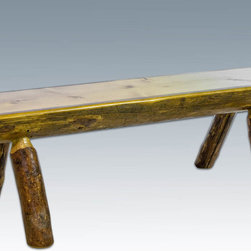 """Montana Woodworks - Glacier Country Half Log Bench 4ft - Treat yourself and your family to this unique half log bench. It's perfect for the foot of the bed or those cold nights when you want to sit a bit closer to the fireplace. Handcrafted using one half of a genuine lodge pole pine log sawn lengthwise and supported by four sturdy genuine lodge pole pine legs, this bench will last for generations. Finished in the """"Glacier Country"""" collection style for a truly unique, one-of-a-kind look reminiscent of the Grand Lodges of the Rockies, circa 1900. First we remove the outer bark while leaving the inner, cambium layer intact for texture and contrast. Then the finish is completed in an eight step, professional spraying process that applies stain and lacquer for a beautiful, long lasting finish. Seat depth is approximately 10"""". Comes fully assembled. 20-year limited warranty included at no additional charge. Hand Crafted in Montana U.S.A.; Solid, U.S. grown wood; Unique, one-of-a-kind Glacier Country style.; Heirloom Quality; 20 Year Limited Warranty; Durable Build, Fit and Finish; Each Piece Signed By The Artisan Who Makes It; Solid genuine lodge pole pine; Super Strong, Half Log Design. Dimensions: 48""""W x 19""""D x 18""""H"""