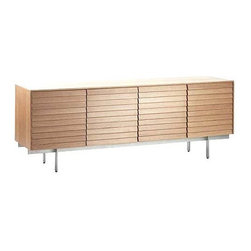 """Punte Mobles - Sussex Credenza - Inspired by the shingled, angled roof of an English cottage, Terence Woodgate's Sussex Collection (2000) is storage defined by compelling wood detail and discreet functionality. Louvered doors are beautifully integrated into this Credenza with richly grained veneer, carefully chosen by hand for consistency. Each piece is finely finished on all sides, so it can act as a room divider. Assembly required. Made in Spain. Each of the four compartments has an adjustable shelf to accommodate large and small objects, and center cabinets have cord escapes for media storage. Shelves can support 106 lbs. each, top surface can support 220 lbs. Can be used for media storage, bedroom storage or as a console, and at 29"""" high it fits behind most sofas. Leveling glides for uneven floors. All wood comes from controlled and sustainably farmed forests. DWR Exclusive"""