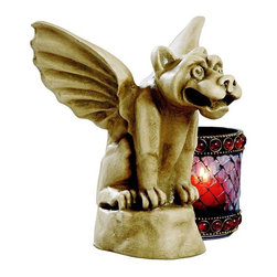 Design Toscano - Design Toscano Florentine Gargoyle Statue - Small Multicolor - EU1393 - Shop for Sculptures Statues and Figurines from Hayneedle.com! He may not be known for his good looks but the Design Toscano Florentine Gargoyle Statue - Small definitely adds a distinctive touch. Quality designer resin construction makes this piece a lasting addition to your home or garden. A striking stone finish is the perfect accent to this watchman. A round base provides better stability for durability.About Design ToscanoDesign Toscano is the country's premier source for statues and other historical and antique replicas which are available through the company's catalog and website. Design Toscano's founders Michael and Marilyn Stopka created Design Toscano in 1990. While on a trip to Paris the Stopkas first saw the marvelous carvings of gargoyles and water spouts at the Notre Dame Cathedral. Inspired by the beauty and mystery of these pieces they decided to introduce the world of medieval gargoyles to America in 1993. On a later trip to Albi France the Stopkas had the pleasure of being exposed to the world of Jacquard tapestries that they added quickly to the growing catalog. Since then the company's product line has grown to include Egyptian Medieval and other period pieces that are now among the current favorites of Design Toscano customers along with an extensive collection of garden fountains statuary authentic canvas replicas of oil painting masterpieces and other antique art reproductions. At Design Toscano attention to detail is important. Travel directly to the source for all historical replicas ensures brilliant design.