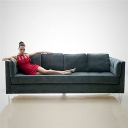 Anson Sofa by H Studio - The Anson Sofa updates a retro shape with modern detailing and materials, making it the perfect piece for stylish homes of all eras.