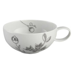 Kemi Cup - Inspired by traditional Portuguese embroidery, a new take on floral dinnerware scatters graphic black botanical sprigs across white porcelain pieces with classic coupe shapes and subtle ridge detail.