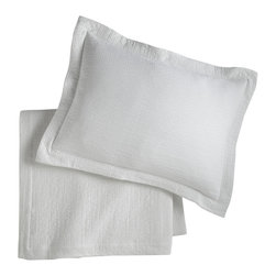 Peacock Alley - Bradley Sham, White, Euro - Can you say matelassè? It's the stitching technique that lends this pillow sham its thick, quilted, incredibly comfy texture. Here, in a warm and easy earth tone and 100 percent Egyptian cotton, it brings relaxed sophistication to your bedroom.