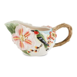 Fitz and Floyd - Fitz and Floyd 29-559 Flourish Creamer - 29-559 - Shop for Condiment Supplies from Hayneedle.com! It's springtime anytime with the Fitz and Floyd 29-559 Flourish Creamer as part of your tea or coffee set. A happy hummingbird sits at the ready waiting to pour your cream. The twig-like side handle adds a charming touch while a wide mouth ensures easy pouring. Part of the Flourish collection.About Fitz and FloydFitz and Floyd is recognized worldwide as a leader amongst the style- and quality-conscious. For 50 years their unique designs have made them the leader in the purveyor of hand-painted ceramic dinnerware tableware accessories giftware and collectibles. All Fitz and Floyd pieces are easy to spot. Each piece is distinctively hand-crafted by artisans from the drawing board to the sculpting wheel and kiln.The company's Dallas-based studios are renowned for producing over 500 unique designs per year. Creations range from presidential dinnerware for the White House or a tea service for Her Majesty Queen Elizabeth II to the perfect centerpiece for your table and each design is lovingly crafted in the highest quality. Meticulous craftsmanship and exquisite detail make every Fitz and Floyd piece a treasured heirloom-quality gift.