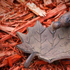 Small Maple Leaf Bird Bath with Bird - This small leaf shaped birdbath is the perfect addition to the nature lovers backyard. The leaf shape and bird attached will sure make any nature lover happy. Made of durable cast iron, with an antique brown finish. Be sure to re-fill this bath often, to keep the water fresh!