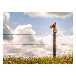 """Retired Cowboy Boot - Western Fine-art Photograph, 36"""" X 27"""" - This well-loved and well-used cowboy boot has some miles on it.  It is only fitting that it's final resting place overlooks the land that it once worked.  Perched on the post of a barbed-wire fence this boot soaks up the sun and remains as tireless and steadfast as it did when worn by its owner."""