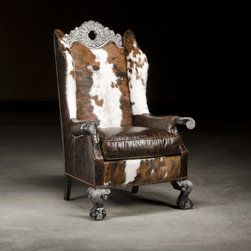 Sofas and Chairs Furniture - This fabulous chair would make a statement in any corner.  The cowhide, and leather selections make this a conversation piece and High Western style.  It is comfortable and will be your families Heirloom piece.