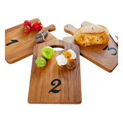 "Europe2You - Vintage Wooden Number Tasting Boards - Define your presentation with a touch of class using our high quality wooden cutting boards. Each of these unique boards is made from 19th-century European timber and can be used for cutting as well as serving.   One, two, and three numerals label each one, so guests are able to identify different cheeses, desserts and fruits! Its rustic finish and fun shapes and numbers will delight anyone who enters your home.                                           * Set of 3                  * Dimensions: W: 7"" H: .5"" D: 13"""