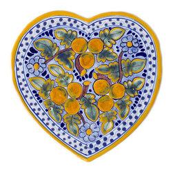Native Trails - Talavera Heart Trivet in Peaches - Delightful and vibrant, our Talavera Heart Trivet in Peaches will brighten any room. Handmade from a combination of the artisans' local clays, then intricately hand painted and then twice fired to bring out the striking colors and create a durable finish, each trivet is an affectionate reminder of the warmth of a summer orchard. Due to the hand-made nature of this piece, details of patterns and colors hues may vary, which makes each cross a unique work of art.