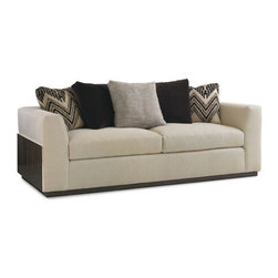 Caracole - Boxed In Sofa - Architectural design in the truest sense is captured here on our new modern sofa. The materials, characteristically clean, with simple lines, and precise proportions, strike a balance between classic and elegant design, by combining, Fumed Eucalyptus veneering, and metal accents in a Gold Bullion tone. Lending depth to this design we add the perfect contrast in our organic diagonal twill weave textured fabric. Eight-way hand tied seats with Spring Down cushions and feather down pillows. Pillows included as shown, including rich chocolate velvet and bold over-sized flame stitch pattern.