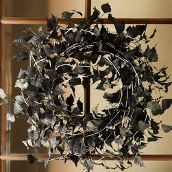 Spooky Aspen Wreath - This feathery wreath would give guests a great spooky welcome through your front door!