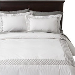 Fieldcrest Luxury Embroidered Hotel Duvet Cover Set, White/Silver - A resort-inspired master bedroom retreat starts with simple white hotel-style bedding. This set is from Target and starts at just $90.