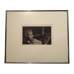 Used Marilyn Monroe Photo by Elliott Erwitt, Signed - There is a reason this photo is one of Elliott Erwitts' most recognizable works. The beauty and innocents of the famous star shines through. This photo is number 199 of 250 in this edition printed and artist signed in 2001 from the original work taken in 1956 in New York.    About the Artist:    Born on July 26, 1928, in Paris, Elliott Erwitt spent his childhood in Milan.  His family moved back to Paris in 1938, and immigrated to New York the following year then moved to Los Angeles in 1941.  His interest in photography began while he was a teenager living in Hollywood.  While attending Hollywood High School, he began working in a commercial darkroom in 1944.  In 1948 Erwitt moved to New York, there he met Edward Steichen, Robert Capa and Roy Stryker.  After spending the year 1949 traveling in France and Italy, Erwitt returned to New York and began working as a professional photographer.  Drafted into the army in 1951, he continued to take photographs while stationed in Germany and France    Elliott Erwitt was invited to join Magnum Photos in 1953 by Robert Capa.  A member of the prestigious agency ever since, Erwitt has served several terms as its president .  One of the leading figures in the competitive field of magazine photography, Erwitts journalistic essays, illustrations, and advertisements have been featured in publications around the world for more than forty years.    While continuing his work as a still photographer, Erwitt began making films in 1970.  His documentaries includes BEAUTY KNOWS NO PAIN (1971), RED WHITE AND BLUEGRASS (1973) made with the assistance of an American Film Institute grant, and the prize winning GLASS MAKERS OF HERAT (1977).  Erwitt has produced seventeen comedy and satire specials for Home Box Office.    Erwitt has had one-man exhibitions in numerous museums and galleries around the world including New York's Museum of Modern Art, the Smithsonian Institution, the Art Institut