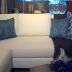 Decorating With Color - This white Tribecca sofa from Norwalk is a great palate on which to add some great color. We added these blue, down-filled pillows in a diamond pattern ($124.95 each) from D.V. Kap Home, the embroidered blue pillows from ADV ($29.95 each) and the Kennebunkport throw soften the white sectional. Elements By K Sorbe