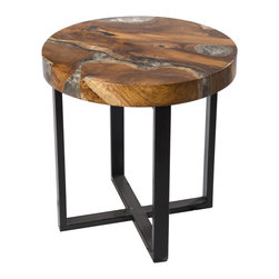 "Petrified Forests - Round Cracked Resin Side Table - Our Cracked Resin Furniture is where art and earth collide. Salvaged teak roots are molded in resin, which is then cracked to emulate quartz. No two pieces look the same, so the picture you see here is just an approximation of what you'll get. (Trust us, you'll love it.) This piece, like all of our pieces, is a completely unique piece of furniture. Side table with round resin mold, an excellent and functional accent to any room.     Height: 18""   Width: 18""   Depth: 18""    Weight: 20 lbs"