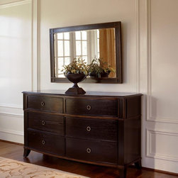 Brownstone Inc. - Metropolitan 6-Drawer Dresser Multicolor - BRW145 - Shop for Dressers from Hayneedle.com! The French-inspired design of the Metropolitan 6-Drawer Dresser along with its high-quality construction makes it a beautiful addition to your bedroom. Constructed of the finest-grade Mindi hardware and Mindi veneers this dresser is made of eco-friendly materials. It features an Ebony finish with Merlot undertones and crackled gold trim. This high-lacquer finish is typical of what you would find on Chinese antiques. It features custom antiqued brass hardware formed into circular drawer pulls. Six total drawers will offer adequate bedroom storage. The bowed drawer fronts and serpentine top add the finishing touches.To make this dresser a complete set add the optional mirror. Framed in the same Mindi hardwood the mirror frame also features subtle gold crackle that nicely complements the brass hand-made hardware on the dresser. Beveled edges give the mirror a quality finished look.About BrownstoneBrownstone's mission is to create quality manufactured furniture with innovative and timeless designs. The people of Brownstone pride themselves on ensuring that the highest quality standards are met when building their furniture. Based in Richmond Calif. they select the finest-grade environmentally-friendly woods and use only American-made finishing materials. From bedroom collections to dining and occasional pieces Brownstone's signature is to artfully blend the classic look of traditional furniture with the clean lines of contemporary design. Brownstone's intention is to offer its customers high-design furniture that endures the test of time and is uncompromised in quality.