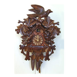 Schneider Cuckoo Clocks - 1-Day 10.6 in. Carved Cuckoo Clock in Mahogany Finish - Carved style. 1-day rack strike movement. Extra deep, very detailed carving of birds and flowers. Casing with structure at both sides. Wooden cuckoo, dial and hands. Shut-off lever on left side of case silences strike, call and music. Made from wood. Made in Germany. 10.6 in. W x 6.3 in. D x 13.8 in. H (4.6 lbs.). Care Instructions