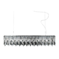 Fabbian - Hungry Linear Suspension by Fabbian - Dish up some truly unique lighting in kitchens or dining rooms with the Fabbian Hungry Linear Suspension, designed by Ali Siahvoshi. The vibrant, silvery gleam it diffuses is courtesy of a drape of stainless steel forks, butter knives, teaspoons and tablespoons, each utensil alternately arranged around a rectangular metal frame. Finished entirely in Polished Chromium plate.In 1961, Fabbian was established in Treviso, Italy, to create quality modern lighting for homes and businesses. Since then, their embrace of advanced manufacturing technology, high production standards and, especially, the innovative designs of a large international team of designers have garnered Fabbian worldwide recognition.The Fabbian Hungry Linear Suspension is available with the following:Details:Stainless steel fork, knife and spoon shadeMetal framePolished Chromium-Plated finishSquare ceiling canopy2 adjustable suspension cables with ceiling supportsUL ListedDesigned by Ali SiahvoshiPlease Note:All of the utensils that make up the Hungry shade are removable, allowing for custom configurations and ease of cleaning.Lighting:Five 60 Watt 120 Volt Type E26 Medium Base Incandescent lamps (not included).Shipping:This item usually ships within 5-7 days.